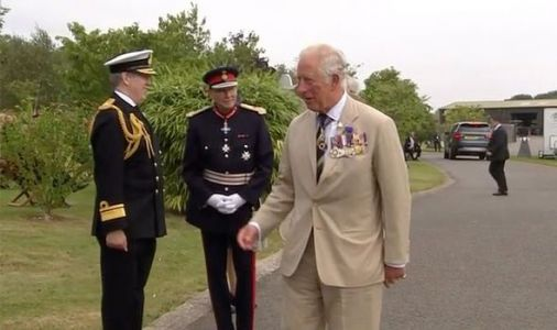 Prince Charles dons his medals as he and Camilla join veterans to commemorate VJ Day