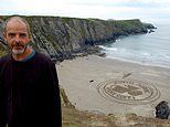 Sand artist who created giant masterpieces in Britain dies of heart attack while swimming in sea