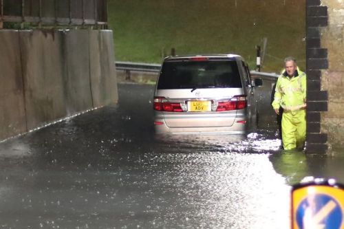Storm Aurore batters UK as cars abandoned in flood water and mini tornado wreaks havoc