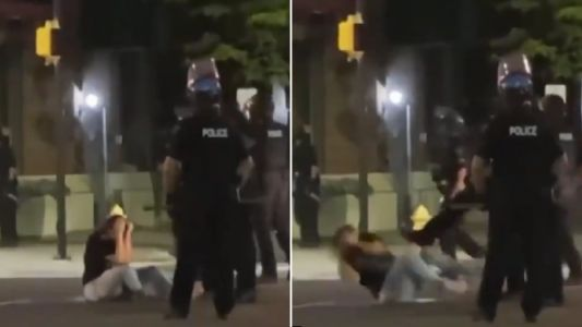 Moment cop kicks George Floyd protester on the ground after pepper-spraying her
