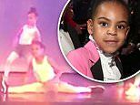 Blue Ivy takes center stage and drops into an impressive split at dance recital
