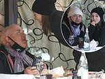 Damien Hirst, 55, delights girlfriend Sophie Cannell, 27, as he larks around during lunch at Scott's