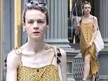 Carey Mulligan steps out in yellow summer dress and a foot brace in rainy NYC after enduring injury