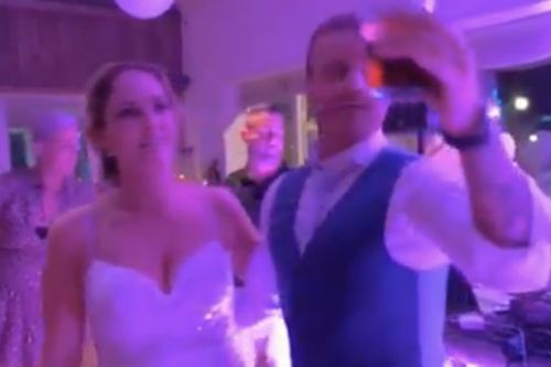 Wedding couple pay tribute to Rangers hero Fernando Ricksen with 'The Best' sing-along at reception