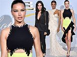 Adriana Lima flaunts her legs in a neon green and black cut-out gown for Hollywood For Science Gala