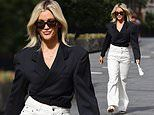 Ashley Roberts looks effortlessly stylish in a plunging black blazer and white bell bottom trousers