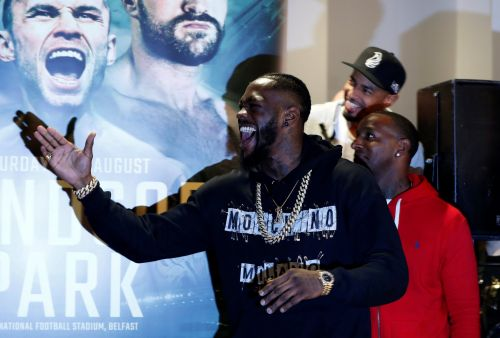 Tyson Fury and Deontay Wilder in chaotic confrontation as American says fight 'will definitely happen'