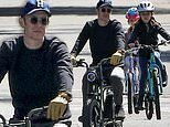 Colin Hanks rides bikes with his daughters after dad Tom and mom Rita Wilson's coronavirus recovery