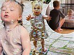 Hilary Duff's daughter Banks, one, blows bubbles before brother Luca, eight, locks her in dog crate