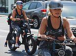 Malin Akerman hits the road while taking a bike ride with her son Sebastian in Los Angeles