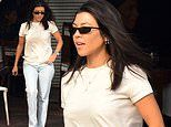 Kourtney Kardashian hides her gym-honed physique as she heads out to lunch with friends in LA