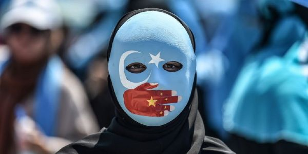 Mysterious automated calls, vanished relatives, and sinister Facebook comments: How China intimidates Uighurs who don't even live in the country