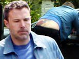 Ben Affleck flashes part of his massive back tattoo during a chat with ex-wife Jennifer Garner