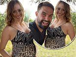 Pregnant Camilla Thurlow displays her growing baby bump as she poses for snap with Jamie Jewitt