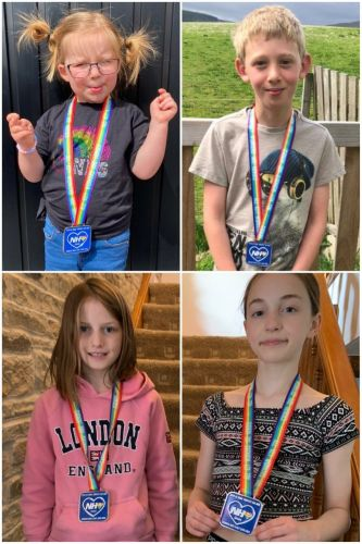 Alford youngster Morgan laps lochs to raise hundreds for NHS charities