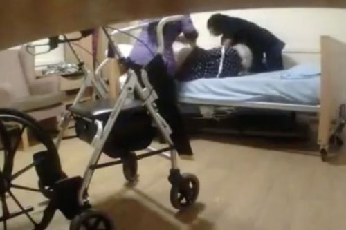 Moment carers drag terrified elderly woman across the room caught on camera