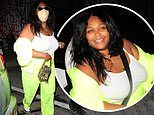 Lizzo shows off her curvy physique in a neon green pants after enjoying dinner at Craig's