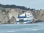 Footage shows the dramatic moment a 522-passenger ferry crashes into rocks as captain loses control