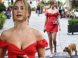 Kimberley Garner looks stylish in a red off-shoulder mini dress as she takes her pooch for a stroll