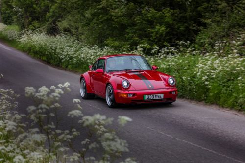 How this boutique car shop uses Tesla powertrains to turn classic Porsche 911 sports cars into new-age EVs