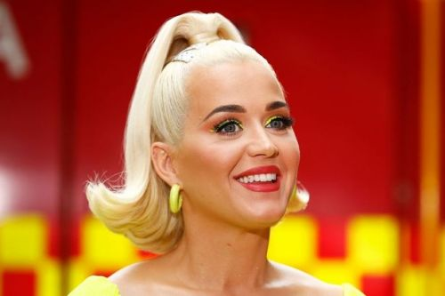 Katy Perry unveils waist-length black hair in dramatic transformation