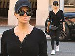 Eva Longoria shows off her toned figure in form-fitting black top