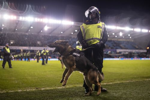 Football fans charged for racist chanting during match