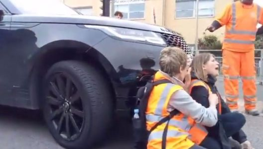 Dramatic moment furious driver in Range Rover drives into Insulate Britain protesters blocking the road