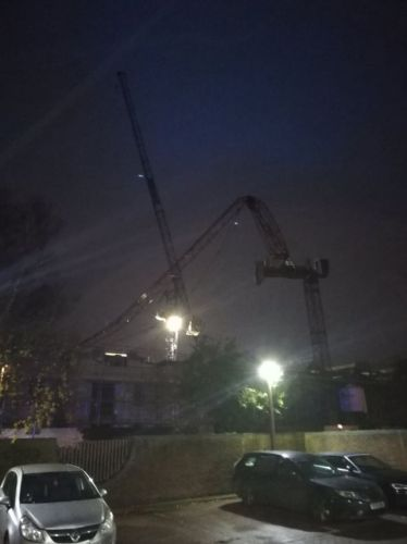 Huge crane 'snaps in half' and collapses onto Kingston University building as 80mph gales hit Britain