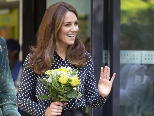 Kate Middleton spoke to other moms about how quickly Prince George is growing up while sporting an $885 outfit