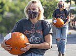 Malin Akerman is picture of all-American fashion in jeans and cowboy boots as she buys a pumpkin