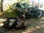 How did anyone survive this? Woman walks away from the mangled wreck of her car after horror smash