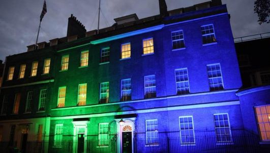 UK buildings shine blue and green for Northern Ireland centenary