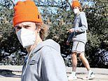 Justin Bieber flashes a peace sign as he takes a solo hike through the Hollywood Hills