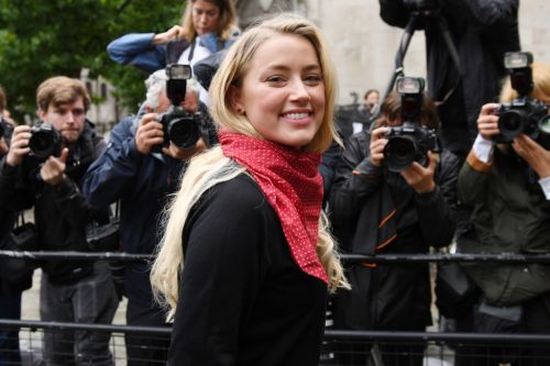 Amber Heard smiles outside High Court as she faces Johnny Depp for second explosive day