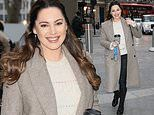 Kelly Brook looks typically chic in a grey tailored coat