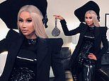 Iggy Azalea looks edgy in a black leather jumpsuit and extravagant bonnet