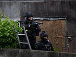 Police negotiate with a man who threatened an emergency worker with a large power tool