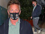 Sean Penn masks up while stepping out for a solo dinner in Santa Monica