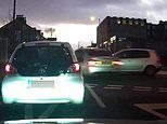 'Idiot boy racer' in BMW nearly zooms over roundabout and hits car making turn