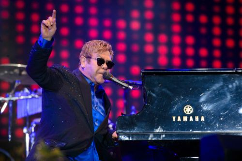 Sir Elton John forced to postpone Farewell Yellow Brick Road tour dates to 2023 after suffering fall: 'I'm in considerable pain and discomfort'