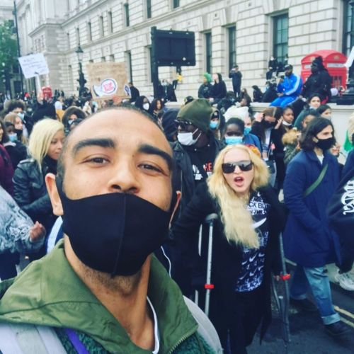 Madonna hobbles on crutches and shouts 'no justice, no peace' as she joins Black Lives Matter protest in London