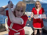 Rebel Wilson shows off her 18kg weight loss as she completes an arm workout while on a yacht
