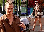 Karlie Kloss is all smiles while taking a stroll with her baby Levi Joseph in Saint-Tropez