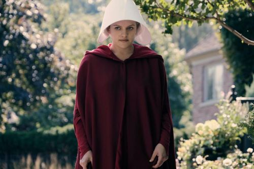 Why does Offred wear a red cape in The Handmaid's Tale and does the colour symbolise fertility?