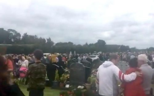 Car speeds into crowds at Irish cemetery, leaving grandfather seriously injured