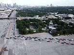 Thousands of cars form a mile-long line at Dallas food bank after unemployment benefits were reduced
