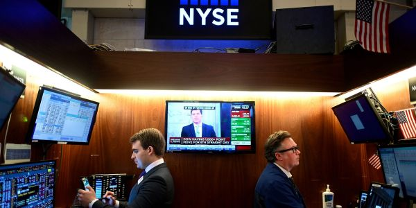 US stocks close mixed with Nasdaq near record as investors weigh new Fed guidance