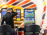 Cash lost to betting machines fell by nearly HALF last year