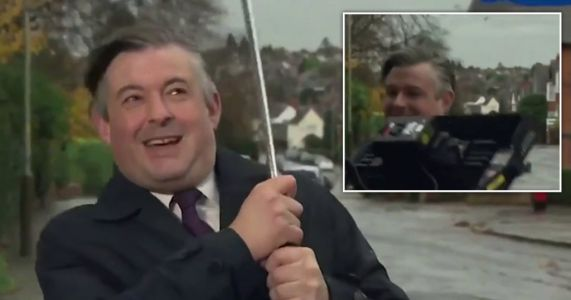 Labour minister nearly hit by light as he battles weather in live TV interview